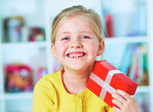 Girl holds gift — Stock Photo