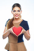 Woman holds  heart — Stock Photo