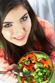Woman eats salad — Stock Photo