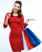 Shopping woman portrait isolated. Shopping bags. White backgrou — Stock Photo