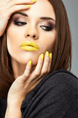 Woman with yellow lips — Stock Photo