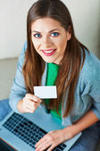 Woman shopping with laptop — Stock Photo