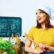 Young woman in kitchen. — Stock Photo #45913375