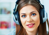 Girl with headphones listening music at home. — Stock Photo