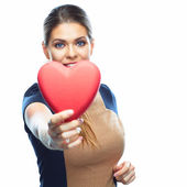 Young smiling woman hold heart. — Stock Photo