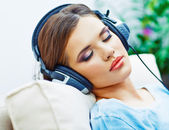 Sleeping woman at home with headphones — Stock Photo