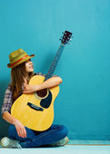 Girl sitting with guitar. — Stock Photo