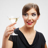 Toothy smiling young woman drink white wine — Stock Photo
