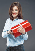 Woman holds gift box — Stock Photo
