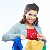 Woman holding clothes — Stock Photo