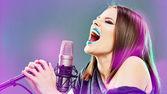 Woman and microphone — Stock Photo