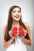 Woman holds gift. — Stock Photo