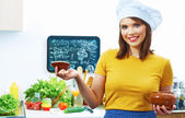 Woman chef in kitchen — Stock Photo