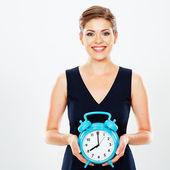 Business woman holds watch — Stockfoto