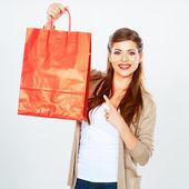 Woman shows shopping bag. — Stock Photo