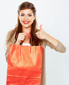 Woman holding shopping bag — Stock Photo