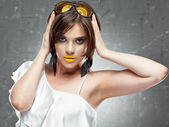 Woman with yellow lips and glasses — Stock Photo