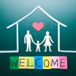 Welcome word and Family in house — Stock Photo