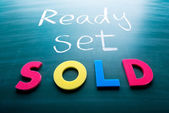 Ready, set, sold! — Stock Photo