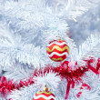 Stock Photo: Christmas red balls and decorations on white Christmas tree