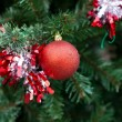 Christmas red balls and decorations on Christmas tree — Stock Photo #36071059