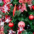 Christmas red balls and decorations on Christmas tree — Stock Photo