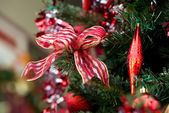 Ribbon and decorations on Christmas tree — Stock Photo