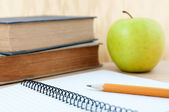 School equipment with apple — Stock Photo