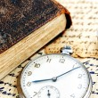 Antique book and clock — Stockfoto