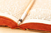 Opened antique book with fountain pen — Stock Photo