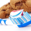 Toothbrush and cakes — Stock Photo