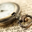 Pocket watch on book — 图库照片
