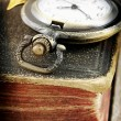Old book and pocket watch (macro photo) — Stock Photo