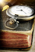 Old book and pocket watch (macro photo) — Foto Stock