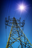 High tension line with Sun — Stock Photo