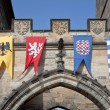 Stock Photo: Pennants with coat of arms of city Prague on tower