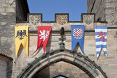 Pennants with the coat of arms of city Prague on a tower — Stock Photo