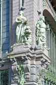 Sculptures on ancient building — Stock Photo