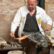 Glassblower at work - Stock Photo