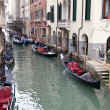 Gondolas and gondoliers - Stock Photo