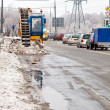 Cleaning up of streets from wet snow - Stock Photo