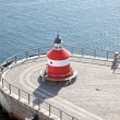 Lighthouse on the pier — Stock Photo