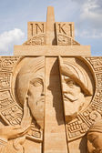 Shortlived sculpture from sand. Cross and Sword — Stock Photo