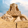 Shortlived sculpture from sand. Hammer of Thor — Stock Photo