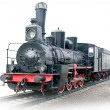 Steam locomotive with wagon — Stock Photo