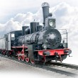 Stock Photo: Steam locomotive with wagon