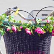 Flowers on bicycle basket — Stock Photo #33225195