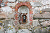 Window in the thick wall — Stock Photo