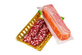 Bacon on a rural and sliced sausage  — Stock Photo