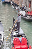 Gondolas and gondoliers — Stock Photo